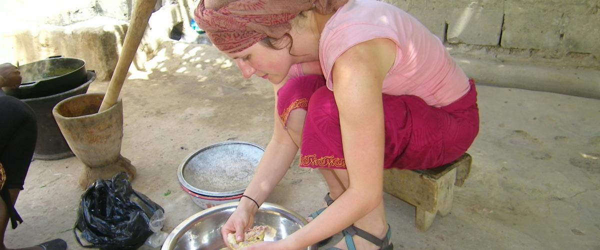 Susannah Chapman works with others preparing food.