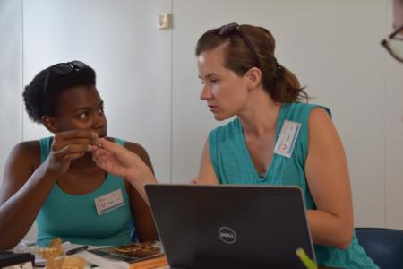 Laurie Reitsema (right) and a student do computer research.